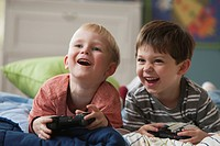 Caucasian boys playing video game