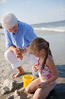 Caucasian grandmother and granddaughter enjoying beach