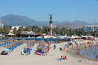 Tourists enjoy the beach in Puerto Banus, Marbella, Andalusia, Spain, Europe