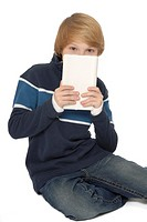 Eleven year old boy holding a computer tablet