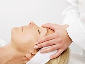 Mature woman receiving massage, close up