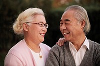 Older couple looking at each other and smiling