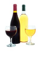 Bottles of red and white wine and a glass of red and white wine