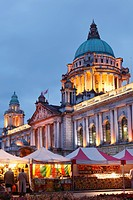 United Kingdom, Ireland, Ireland, Northern Ireland, Belfast, View of city hall at dusk with market stalls in foreground