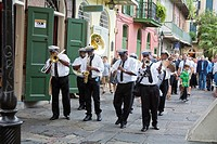 Paulin Brothers Brass Band playing music and leading a funeral procession in the French Quarter of New Orleans, LA