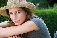 Smiling woman wearing sunhat outdoors