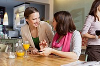 Smiling women talking in cafe