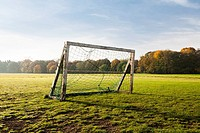 A wooden goal on an amateur soccer field