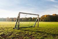 A wooden goal on an amateur soccer field