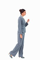 Side view of walking businesswoman against a white background