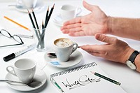 Close book world coffee and human hands on table with coffee cups