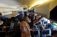 Passengers in cabin of jet aircraft                                                                                                                   ...