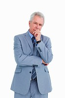 Mature tradesman in thinkers pose against a white background
