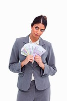 Female entrepreneur holding bank notes against a white background