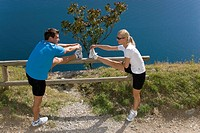 Man, woman, stretching, running, railing, stretch practise, rest, health, fitness, sport, Ausdauert, nature, lake Garda, Italy,