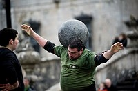Juan Jose Unanua ´Goenatxo´, stone lifter or harrijasotzaile in Basque language  Exhibition in Azkoitia where he lifts a heavy round stone and moves i...