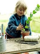 Blonde girl gardening