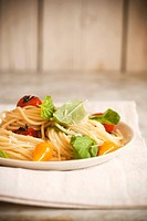 Spaghetti with Yellow and Red Tomatoes and Fresh Basil Leaves
