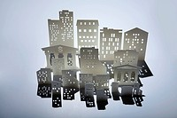 Architectural model of buildings and a bank with dollar sign