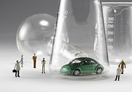 Close_up of toy car in conical flask and small figurine