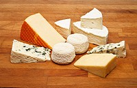 Cheese on a wooden board - Camembert, Roquefort, Cheddar, St Paulin and Goats cheese