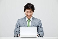 Portrait Of Asian Businessman Using Laptop