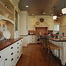 Wood Floor and Countertops in Kitchen with Pressed Tin Ceiling