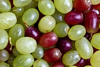 Green and red grapes background