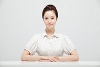 Asian Businesswoman Sitting In Front Of Desk