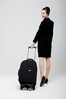 Asian Businesswoman Walking With Luggage