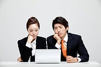 Boredom Asian Businesswoman Businessman Sitting At Desk With Laptop