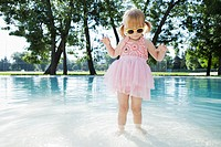 Girl 3-4 in costume standing in water (thumbnail)