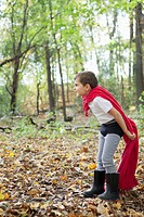 Boy 5_6 in costume playing in forest