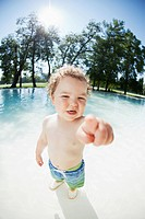 Portrait of cute boy 3-4 at pool (thumbnail)
