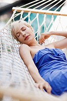 Woman napping in hammock (thumbnail)