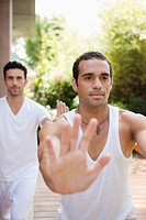 Two men practicing yoga (thumbnail)