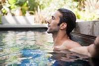 Man relaxing in pool