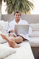 Man using laptop in health spa