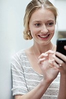 Portrait of smiling woman using cell phone