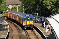 Train arrives to collect commuters at west London station