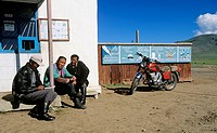 Men having rest in countryside, Mongolia