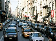 lower broadway busy shopping street and traffic in soho new york city