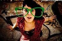 Young woman with funny eyeglasses