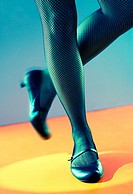 Close up of a tap dancer's legs