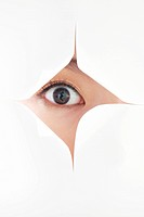 woman´s eye visible through a gap