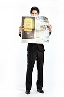 Businessman looking at Newspaper