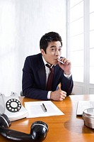 Businessman smoking at desk