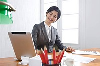 Businesswoman using Tablet PC at desk