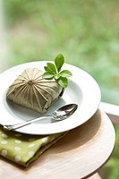 Boiled rice wrapped with lotus leaf