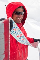 a mountain guide pulls the skins off his skis. Icefall Lodge, Golden, British Columbia, Canada